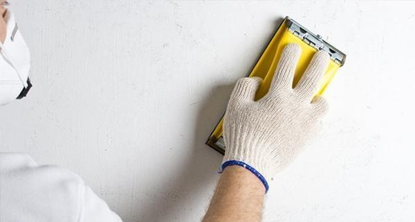 Шкурение гипсокартонной стены перед покраской