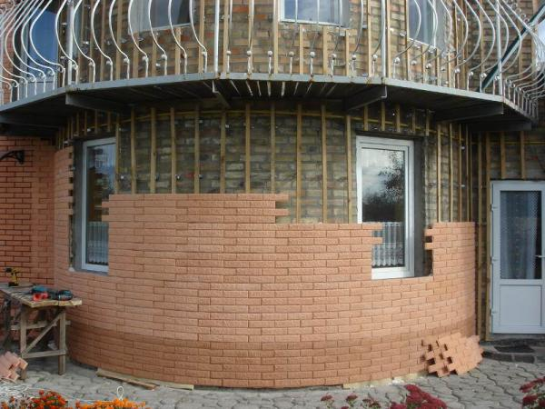 фото облицовки фасада дома кирпичом