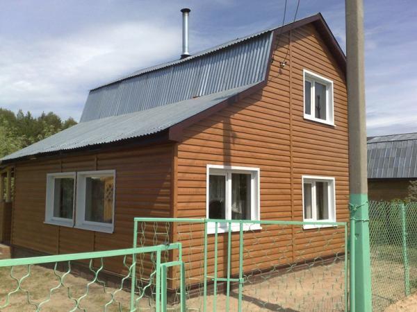 Дом, отделанный металлосайдингом